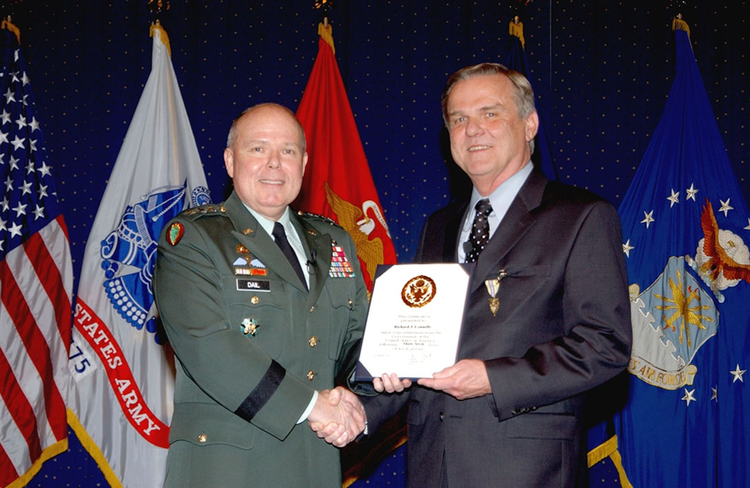 DLA Hall of Fame inductee Richard Connelly, right, at his retirement ceremony in 2007 with then-DLA Director Army Lt. Gen. Robert Dail, who is also a 2014 inductee.