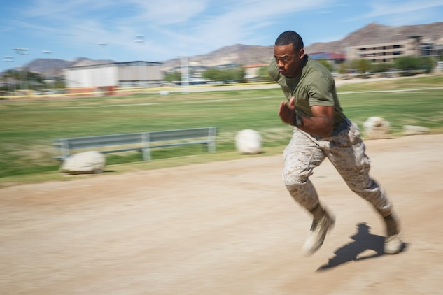 Corporal Joshua Boozer, an ammunition technician assigned to Company B, 1st Tank Battalion, 1st Marine Division, sprints on a track aboard Marine Corps Air Ground Combat Center Twentynine Palms, Calif., Oct. 7, 2015. Boozer participated and won the U.S. Marine Corps High Intensity Tactical Training Ultimate Tactical Athlete Championship. (U.S. Marine Corps photo by Lance Cpl. Levi Schultz)