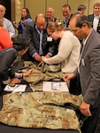 Vendors and supply chain reps from Clothing and Textiles discuss the Army's new Operational Camouflage Pattern uniform during the Joint Advanced Planning Brief for Industry June 16 in Cherry Hill, New Jersey. The two-day event included more than 260 vendors, 40 customers and a Captains of Industry meeting with DLA Director Air Force Lt. Gen. Andy Bush.