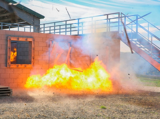 Marines with Company B, 1st Combat Engineers Battalion, 1st Marine Division, I Marine Expeditionary Force, detonate an explosive charge to perform a breach and clear of a structure aboard Marine Corps Base Camp Pendleton, Oct. 7, 2015. Breaching and clearing involves setting and detonating an explosive charge at the entrance of a structure to engage any hostile forces that may be inside.
