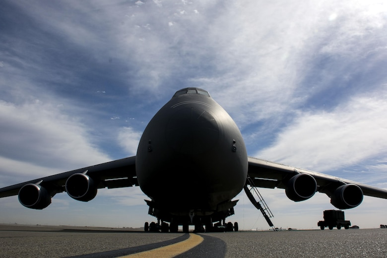 The first of two upgraded C-5C Super Galaxy aircraft was tested to verify if the aircraft still met the vibroacoustics requirements set forth by NASA Sept. 24, 2015, at Travis Air Force Base, Calif. Travis AFB is home to the Air Force's only two aircraft specially modified to insert and transport NASA space containers into the aft end of the cargo compartment. With the recent completion of the Reliability Enhancement and Re-Engining Program upgrade, Air Force Space Command raised concerns regarding the vibratory environments of the cargo compartment, thus requesting the collection of the aircraft's interior noise and vibration data to verify that the M-model SCM cargo compartment was still compliant with NASA requirements. (U.S. Air Force photo/Senior Airman Charles Rivezzo)