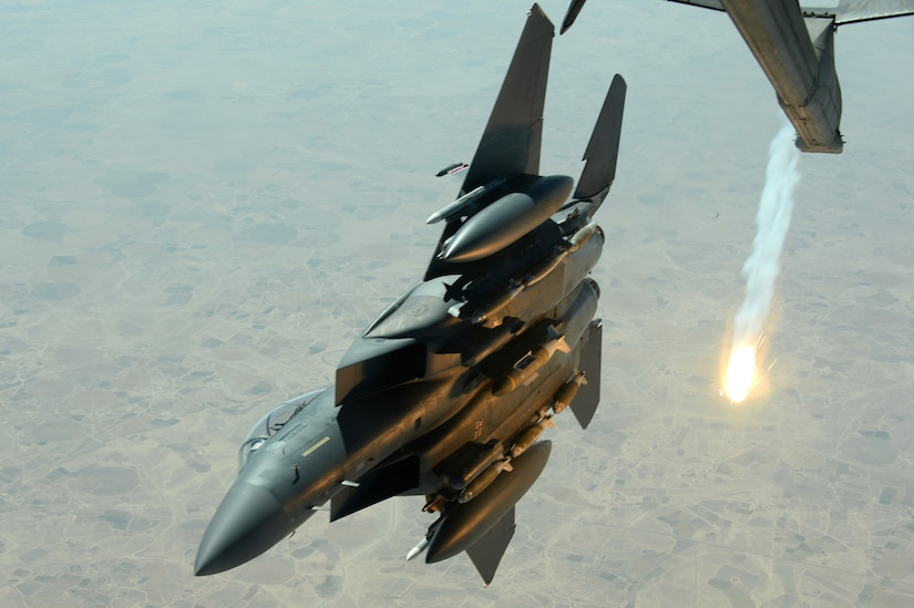 An Air Force F-15E Strike Eagle pops a flare while departing after refueling with a KC-10 Extender tanker over Southwest Asia in support of Operation Inherent Resolve, Aug. 30, 2015. Air Force photo by Staff Sgt. Sandra Welch