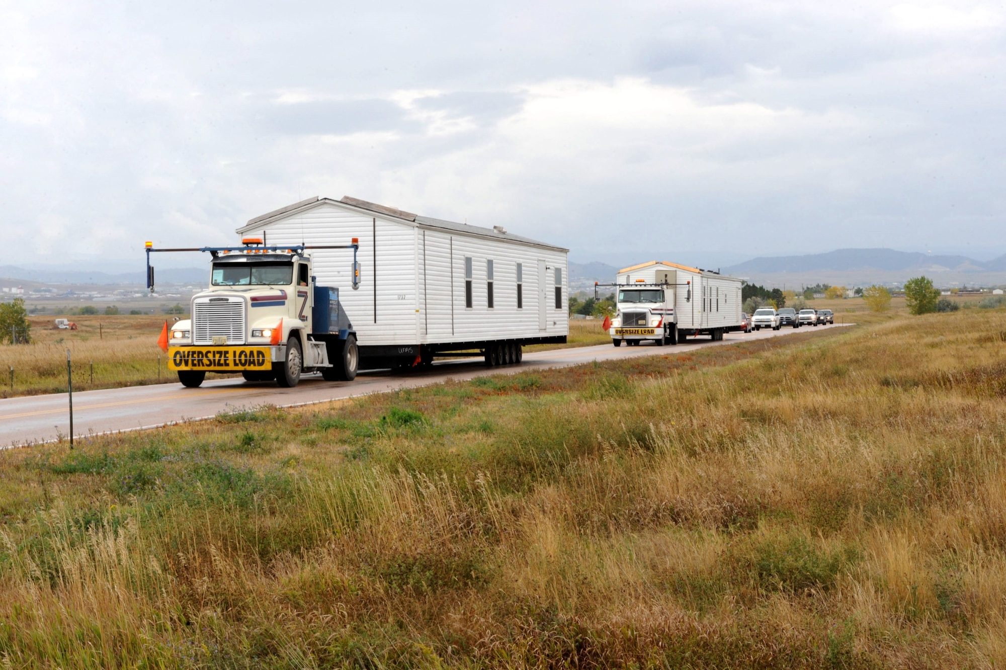 The first two manufactured housing units, part of the Federal Emergency Management Agency's response and recovery efforts related to severe storms and flooding on the Pine Ridge Indian Reservation, arrived at Ellsworth Air Force Base, S.D., Oct. 8, 2015, after traveling from housing storage facilities in Selma, Ala., and Cumberland, Md. The base will serve as the staging area for the FEMA operation, providing space to store the units that will be used to house residents with damaged homes. (U.S. Air Force photo/Airman 1st Class Denise Nevins)