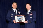 Air Force Brig. Gen. Gregory Otey, director of the Nuclear Enterprise Support Directorate at the Defense Threat Reduction Agency, presents a token of appreciation to guest speaker Air Force Maj. Gen. Robert Wheeler following the 68th birthday celebration of the Air Force Sept. 10 at McNamara Headquarters Complex.