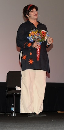 """Michal, played by Naomi Ackerman in the monologue, """"Flowers Aren't Enough,"""" speaks of her life as an abused woman at the Base Theater, recently, to recognize October as Domestic Violence Awareness Month. The play was performed to bring awareness to domestic abuse and provide an opportunity for dialog concerning the issue."""