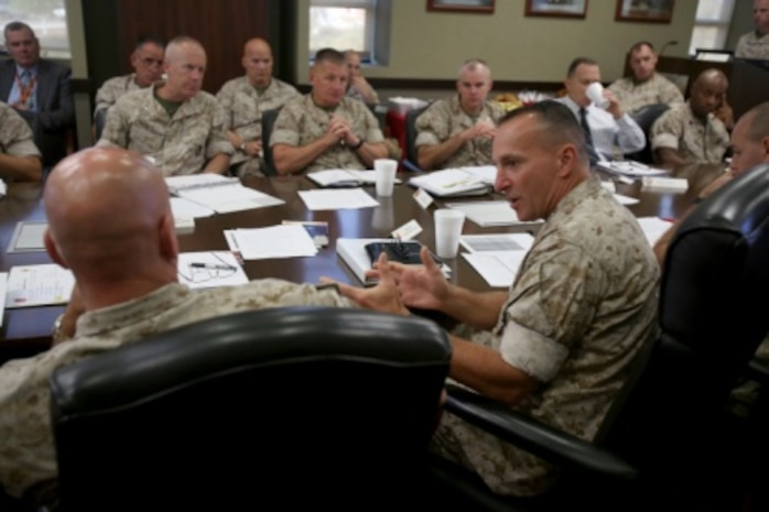 Brigadier General David A. Ottignon, commanding general, 1st Marine Logistics Group, and Brig. General Charles G. Chiarotti, commanding general, 2nd MLG, discuss organizational details during a Quad MLG Conference where the commanding generals of the four Marine Logistics Groups came together in an effort to plan for future organization and logistic changes that will affect their units, aboard Camp Pendleton Calif., Oct. 7, 2015. The four general officers discussed various topics and proposed plans that will help them stay on the same page while simultaneously operating within their specific operational capabilities and capacities.