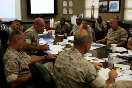 Brigadier General David A. Ottignon, commanding general, 1st Marine Logistics Group, explains his thoughts during a Quad MLG Conference where the commanding generals of the four MLGs came together in an effort to plan for future organization and logistic changes that will affect their units, aboard Camp Pendleton Calif., Oct. 7, 2015. The four general officers discussed various topics and proposed plans that will help them stay on the same page while simultaneously operating within their specific operational capabilities and capacities.