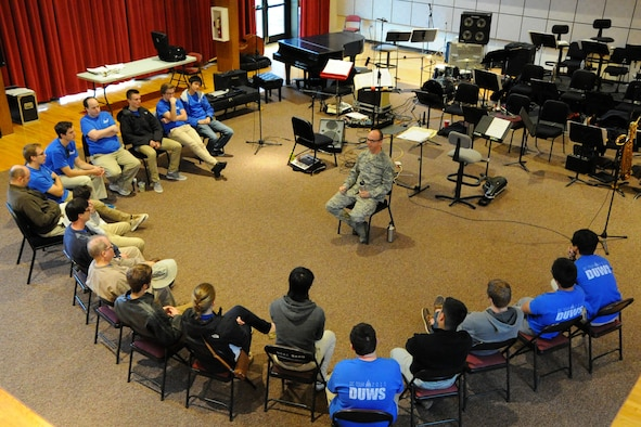 U.S. Air Force Concert Band trumpeter Technical Sgt. Micah Killion speaks to students from Duke University during a Masterclass session at Joint Base Anacostia-Bolling, Washington D.C., Oct. 13, 2015. The members of Duke University's Wind Symphony visited the U.S. Air Force Band today for an immersion in music and Air Force culture. The students attended Masterclass sessions led by performers from the Band to further develop mastery of their instruments before watching the Concert Band's final rehearsal before their fall tour. (U.S. Air Force photo/Staff Sgt. Matt Davis)