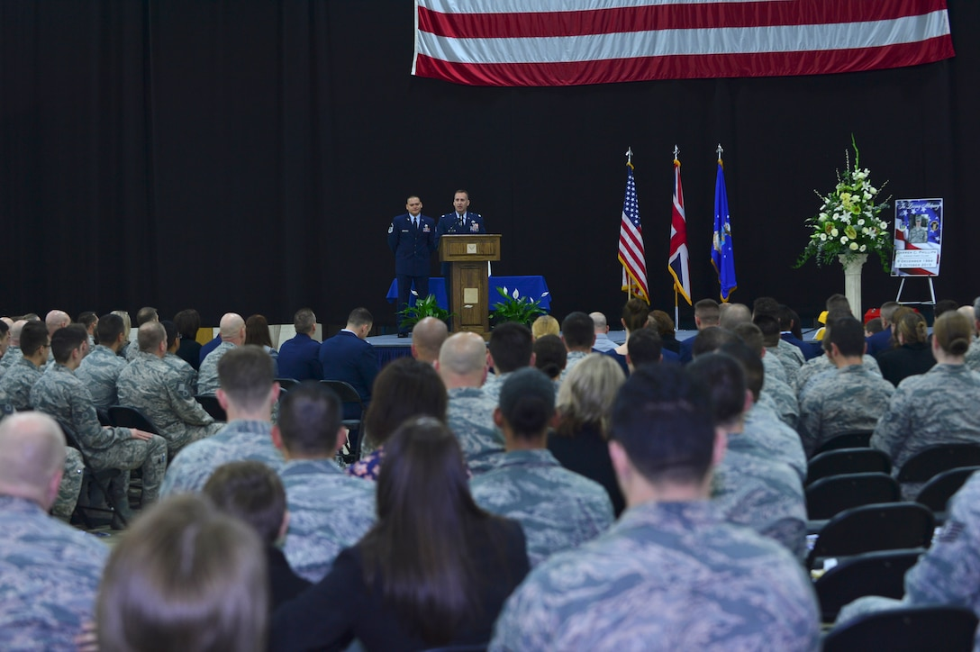 Lt. Col. Ronald Thomas, 48th Equipment Maintenance Squadron commander, gives remarks during a memorial ceremony for Airman 1st Class Darren Phillips, 48th EMS crew chief, at Royal Air Force Lakenheath, England, Oct. 11, 2015. Phillips died from injuries sustained in a motorcycle accident on Oct. 2. (U.S. Air Force photo by Staff Sgt. Stephanie Longoria/Released)