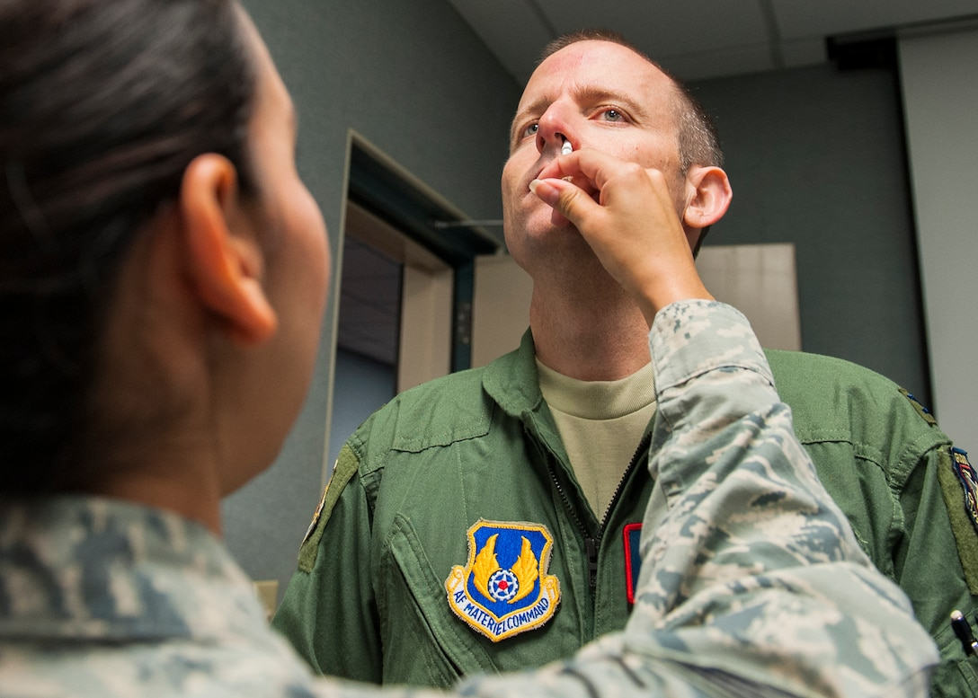 Col. Matthew Higer, 96th Test Wing vice commander, receives a nasal spray flu vaccination Oct. 8 at Eglin Air Force Base, Fla. A mass influenza vaccine line for active duty only is Oct. 26-29 at building 439 from 7 a.m. to 5 p.m. and on Oct. 30 from 7 a.m. to 1 p.m. on a first-come, first-serve basis. The auditorium is located on West F Avenue, across from the library on the East side of the base. Immunization is key to flu prevention and recommended for everyone six-months of age and older.  (U.S. Air Force photo/Ilka Cole)