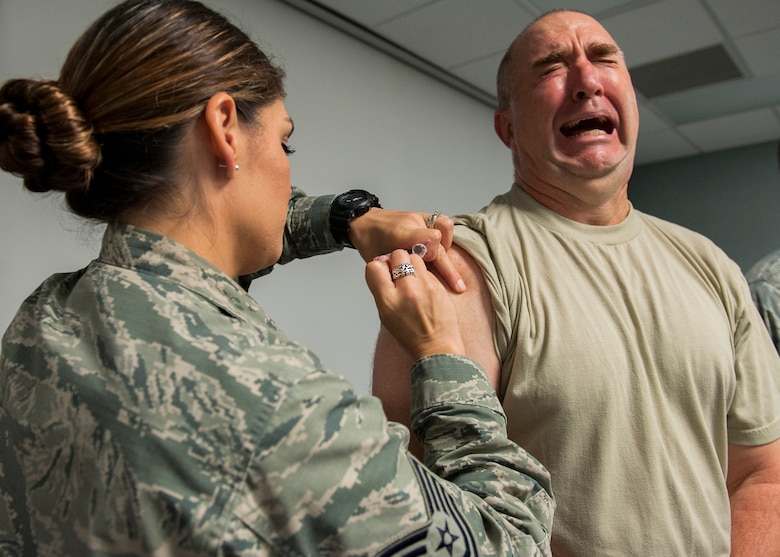 Col. Eric North, 96th Maintenance Group commander, grimaces as he receives a flu vaccination Oct. 8 at Eglin Air Force Base, Fla. A mass influenza vaccine line for active duty only is Oct. 26-29 at building 439 from 7 a.m. to 5 p.m. and Oct. 30 from 7 a.m. to 1 p.m. on a first-come, first-serve basis. The auditorium is located on West F Avenue, across from the library on the East side of the base. Immunization is key to flu prevention and recommended for everyone six-months of age and older.  (U.S. Air Force photo/Ilka Cole)