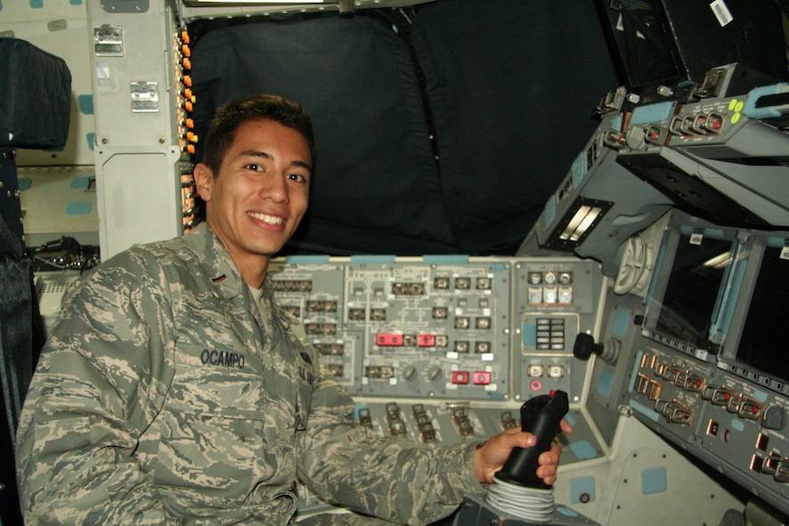 Then 2nd Lt. Rodrigo Ocampo sits in the commander's seat of the space shuttle Endeavour during one of its stops at Edwards Air Force Base, California. Ocampo, who dreamed of going into space as a child, got the rare opportunity to tour the shuttle before it was retired. (Courtesy photo)