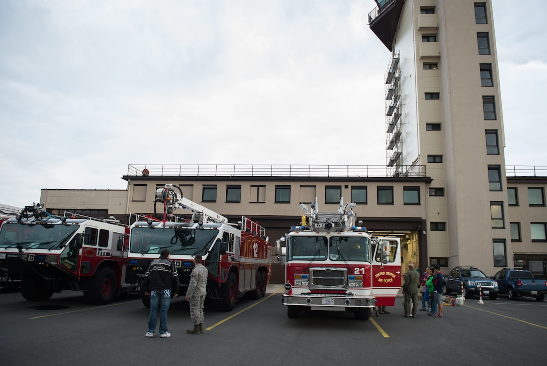 Attendees learn about fire trucks during a Fire Station 1 open house Oct. 8, 2015, at Ramstein Air Base, Germany. The event was hosted by the 86th Civil Engineer Squadron to promote Fire Prevention Week, which was established to commemorate the Great Chicago Fire, the tragic 1871 fire that killed more than 250 people, left 100,000 homeless, destroyed more than 17,400 structures and burned more than 2,000 acres. (U.S. Air Force photo/Senior Airman Damon Kasberg)