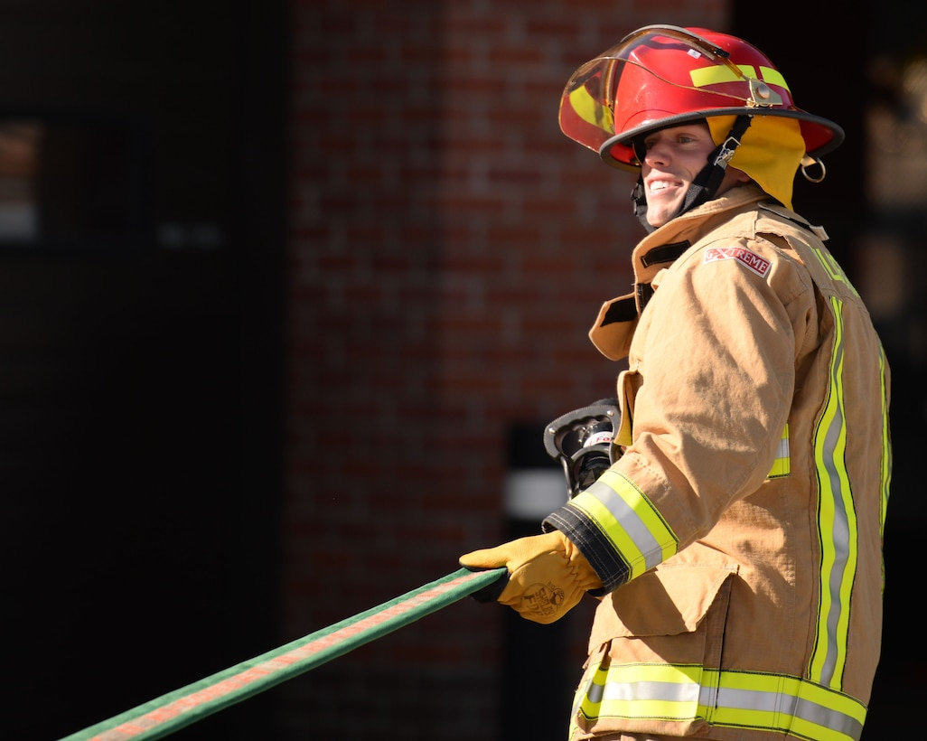 U.S. Air Force Senior Airman Joshua Slater, 100th Civil Engineer Squadron Water Fuels Systems Maintenance journeyman, takes part in the fire muster competition Oct. 8, 2015, on RAF Mildenhall, England. Teams completed nine stations during the competition as part of Fire Prevention Week. (U.S. Air Force photo by Gina Randall/Released)