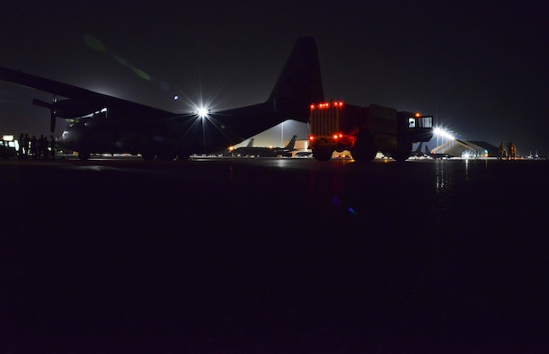 A P-19 Aircraft Rescue Fire Fighting vehicle is parked and ready to be loaded onto a C-130J Hercules assigned to the 746th Expeditionary Airlift Squadron October 12, 2015 at Al Udeid Air Base, Qatar. Aircrew from the 746th EAS received help from Airmen of the 8th Expeditionary Air Mobility Squadron to load the P-19 ARFF vehicle that will be used at a Forward Operating Base. (U.S. Air Force photo/Staff Sgt. Alexandre Montes)