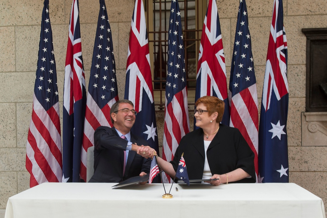 U.S. Defense Secretary Ash Carter and Australian Defense Minister Marise Payne shake hands after signing a U.S.-Australia defense statement at the Boston Public Library during the Australia-U.S. Ministerial Consultations in Boston, Oct. 13, 2015. DoD photo by Air Force Senior Master Sgt. Adrian Cadiz
