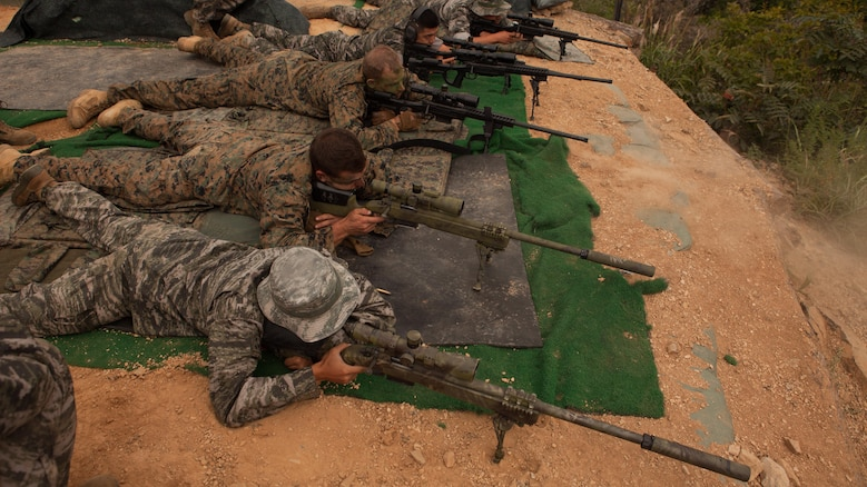 ROK and U.S. Marines fire at targets from 500 meters on the sniper range at Baengnyeongdo, Republic of Korea, Sept. 11, 2015. Marines from both countries exchanged training on weapon systems, methods of concealment, and other capabilities throughout the training. The exercise was part of Korean Marine Exchange Program 15-13, a bilateral training exercise that enhances the ROK and U.S. alliance, promotes stability on the Korean Peninsula, and strengthens ROK and U.S. military capabilities. The scout snipers are attached to Echo Company, 2nd Battalion, 3rd Marine Regiment, currently assigned to 4th Marine Regiment, 3rd Marine Division, III Marine Expeditionary Force, under the unit deployment program. The ROK Marines are with 6th Force Recon Company, 6th Brigade, 2nd ROK Marine Corps Division.
