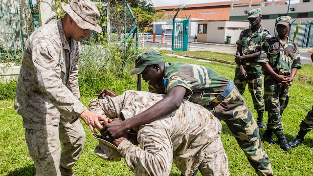 Senegalese military members practice personnel searches with U.S. Marines aboard Bel-Air military base, Sept. 21-22 in Dakar, Senegal. The Marines have participated in multiple training evolutions with the Senegalese military, which reinforces partnership between the two militaries.