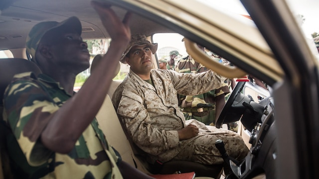 U.S. Marines and Senegalese military members search a vehicle during a two-day training event aboard Bel-Air military base, Sept. 21-22 in Dakar, Senegal. The Marines, based out of Morón Air Base, Spain, are currently validating forward-staging capabilities in Dakar, Senegal, while building partnerships with their Senegalese counterparts.