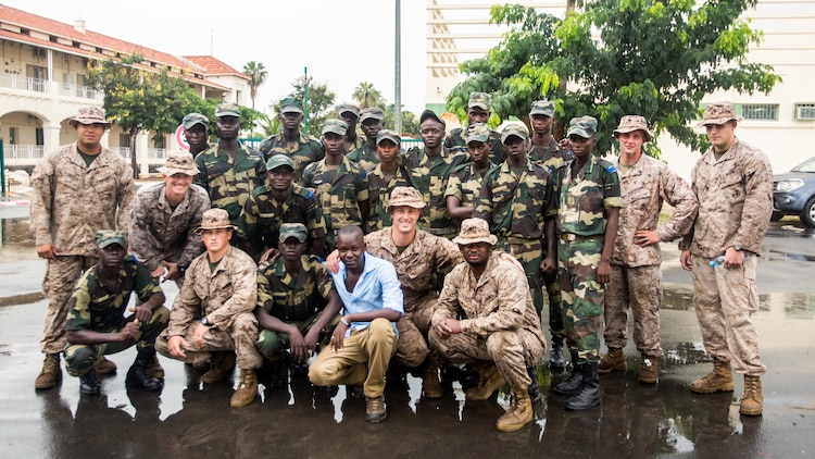 Senegalese military members and U.S. Marines train together aboard Bel-Air military base Sept. 21-22 in Dakar, Senegal. The Marines have spent two days training with Senegalese practicing personnel and vehicle searches while building partnership capacity.