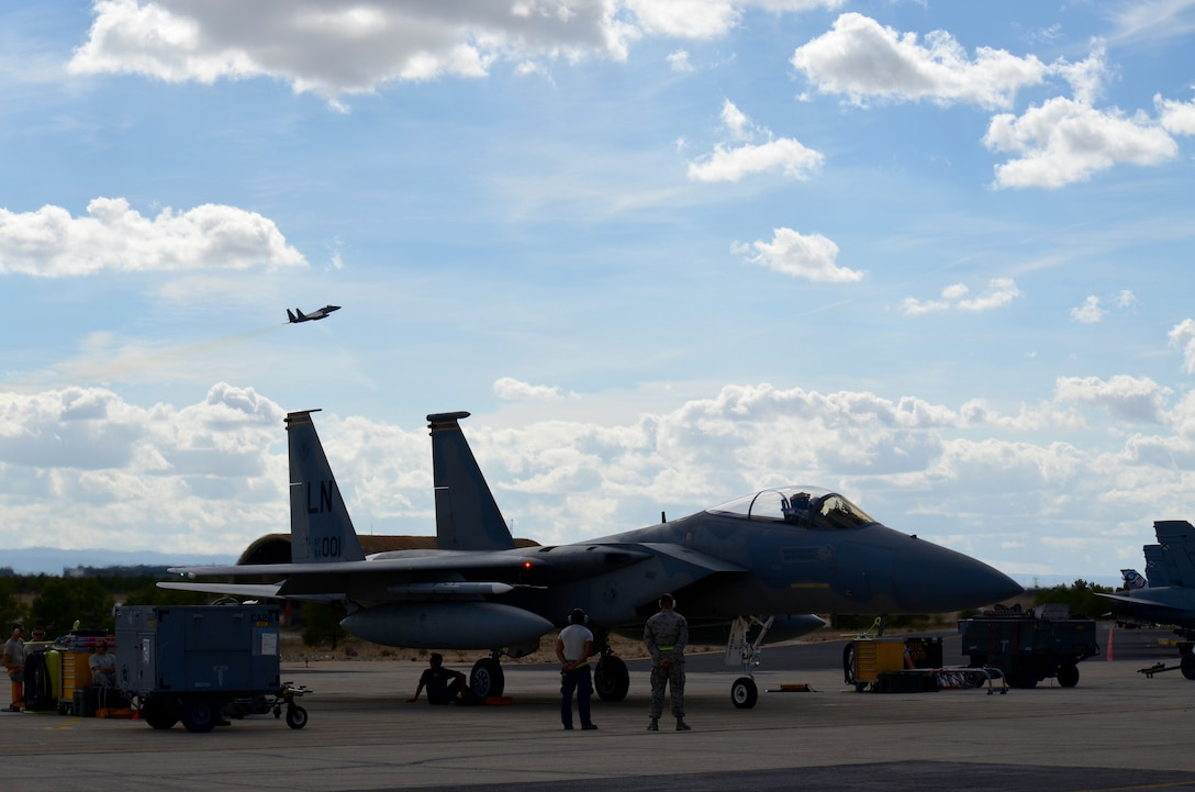 Two F-15C Eagles assigned to the 493rd Fighter Squadron from Royal Air Force Lakenheath, England, prepare for takeoff during the final week of the NATO Tactical Leadership Program in Albacete, Spain, Oct. 8, 2015. Throughout the program, NATO and allied pilots prepared to become mission commanders by leading coalition strike packages and by instructing allied flying and nonflying personnel in matters related to tactical air operations. (U.S. Air Force photo/Capt. Sybil Taunton)