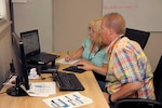 Trudy Crafts-Peck (left), customer training course director, and Tom Kik assist during the Aug. 20 webinar session.