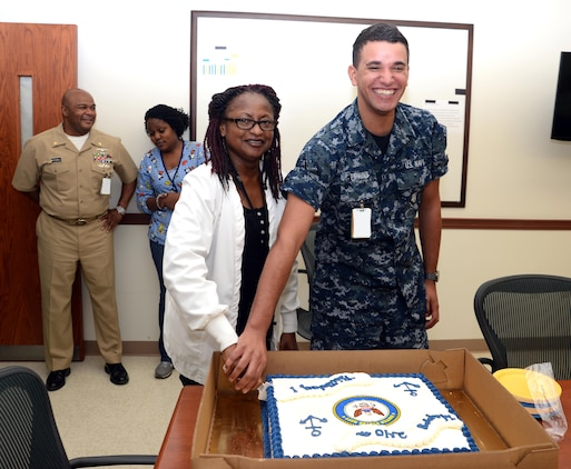 Retired Navy Capt. Patricia Montgomery, family nurse practitioner, and Hospital Apprentice Kailex Pipkins, primary care services, Naval Branch Health Clinic Albany, share in a cake-cutting at Marine Corps Logistics Base Albany, Oct. 13. The event was one of several activities held in celebration of the Navy's 240th birthday.