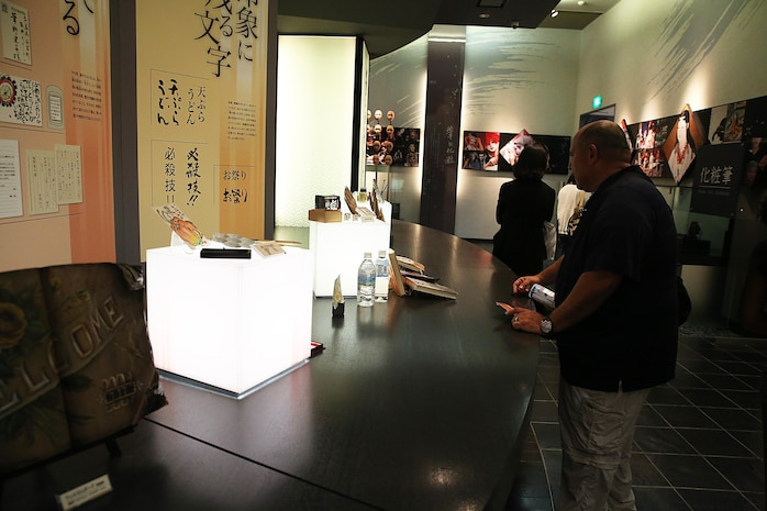 """Marine Corps Air Station Iwakuni, Japan, residents tour Fudenosato Kobo, the official Kumano-fude facility and museum in Kumano, Hiroshima Prefecture, Japan, during a cultural adaption program trip to the annual Japanese Calligraphy Brush Festival, Sept. 23, 2015. Fudenosato Kobo exhibits the largest brush in the world, along with other Japanese """"fude"""" artifacts, artworks and monuments."""