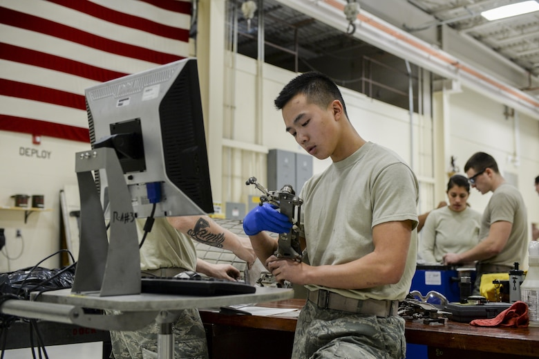 U.S. Air Force Airman 1st Class Brandon Trang, a 354th Maintenance Squadron aerospace propulsion apprentice, inspects parts for damage Oct. 8, 2015, during an engine rebuild in the Engine Shop at Eielson Air Force Base, Alaska. Trang ensured components were safe for continued use and tracked the condition of each part. (U.S. Air Force photo by Senior Airman Peter Reft/Released)