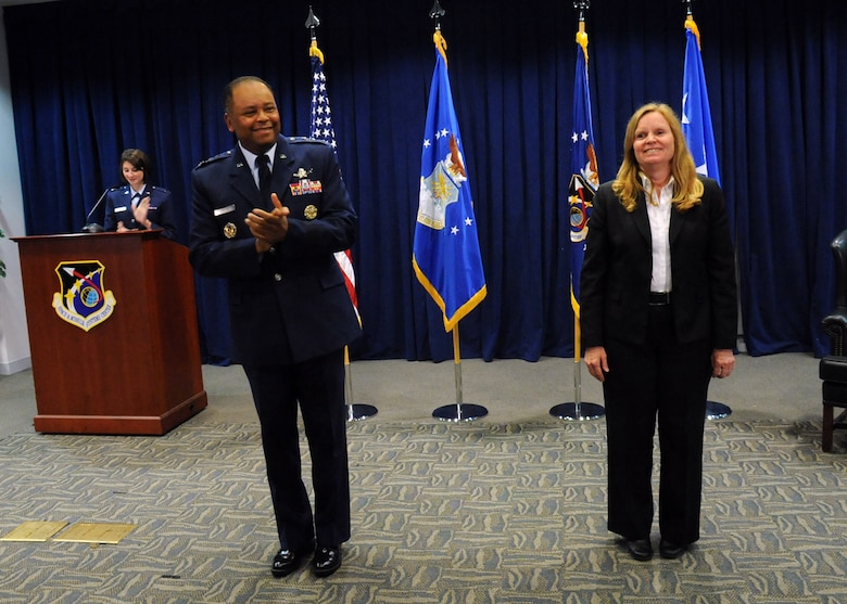Lt. Gen. Samuel Greaves, Space and Missile Systems Center commander and Air Force Program Executive Officer for Space leads the audience in applauding Dr. Claire Leon as the first director of the Launch Systems Enterprise Directorate during a brief stand up ceremony, Oct. 14. (U.S. Air Force photo/Van De Ha)