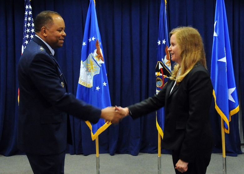 Lt. Gen. Samuel Greaves, Space and Missile Systems Center commander and Air Force Program Executive Officer for Space congratulates Dr. Claire Leon, the first director of the Launch Systems Enterprise Directorate on officially assuming her leadership role during the stand-up of the organization, Oct. 14.