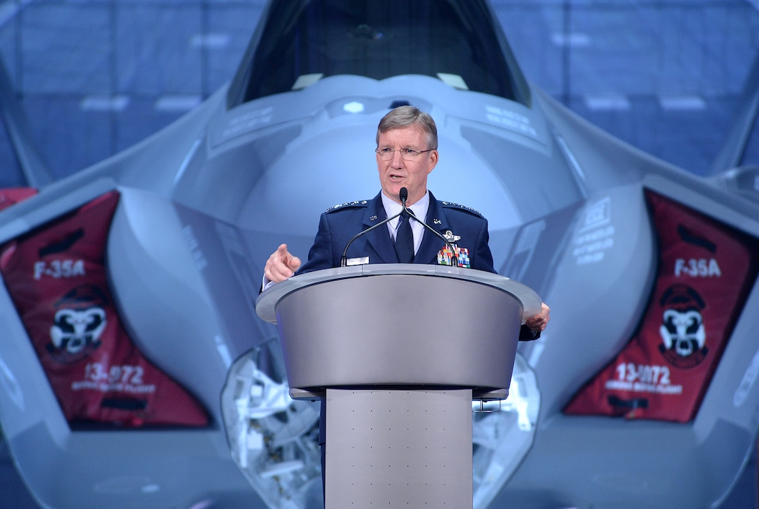 U.S. Air Force Gen. Hawk Carlisle, commander of Air Combat Command, speaks at the arrival ceremony for the F-35 Lightning II at Hill Air Force Base, Utah Oct. 14. The ceremony marked the formal beginning of F-35 operations at Hill, and commemorated the arrival of the first combat-coded F-35 aircraft which arrived at Hill Sept. 2. (U.S. Air Force photo by R. Nial Bradshaw/Released)