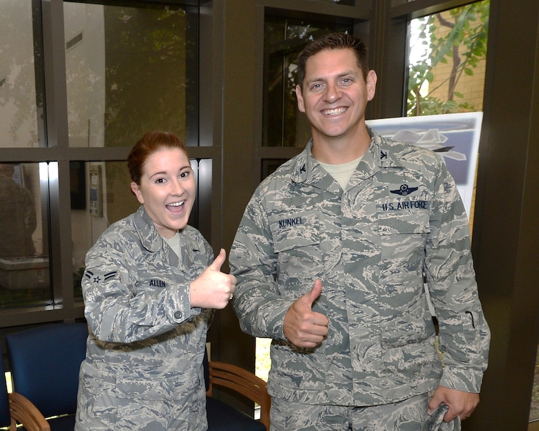 Colonel Joseph D. Kunkel, 325th Fighter Wing vice commander, poses with Airman 1st Class Dana Allen, a 325th Medical Group aerospace medical technician, during a tour of the 325th MDG.  Kunkel has put an emphasis on being involved with many of the Airmen at Tyndall and ensuring they have positive attitudes and experiences in the U.S. Air Force.  (U.S. Air Force photo by Airman 1st Class Cody R. Miller/Released)