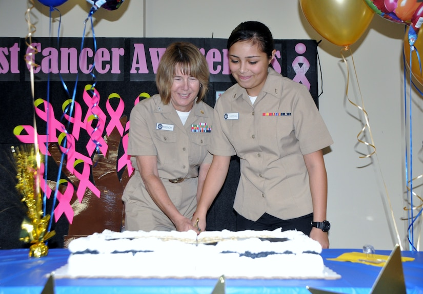 Navy Capt. Jane French, Naval Health Clinic Charleston senior nurse executive (Left) and Hospitalman Recruit Brandy Sandova, general hospital corpsman, cut the cake during NHCC's celebration of the Navy's 240th birthday Oct. 13 at the clinic. (Navy photo/ Kris Patterson)