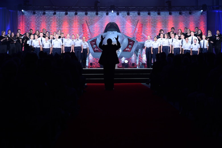 The Utah Military Academy Choir and Weber State University Chamber Choir perform during an F-35A Lightning II aircraft unveiling ceremony at Hill Air Force Base, Utah, Oct. 14, 2015. The unveiling commemorated the arrival of the Lightning II to the base. The 388th and 419th Fighter Wings at Hill were selected as the first Air Force units to fly combat-coded F-35s. (U.S. Air Force photo by R. Nial Bradshaw/Released)