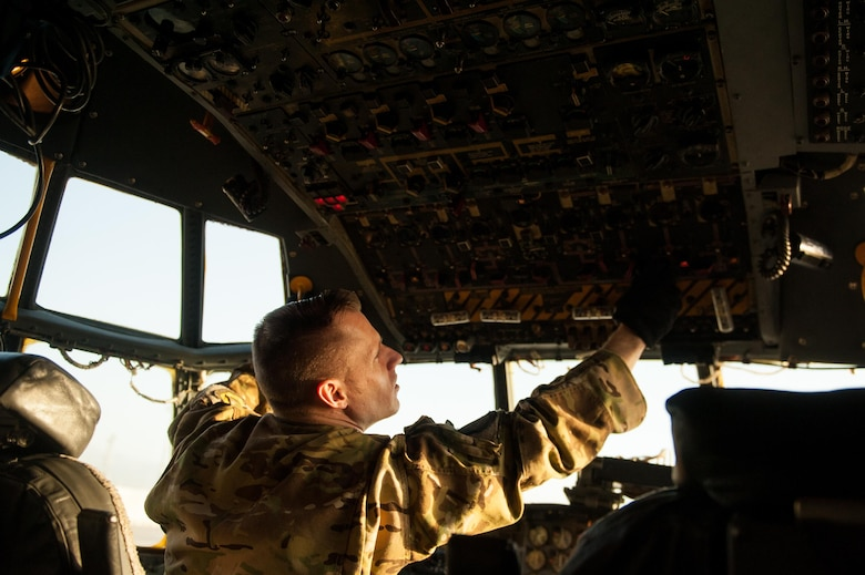 U.S. Air Force Tech. Sgt. John Rorie, 41st Expeditionary Electronic Combat Squadron flight engineer, completes a post flight inspection on an EC-130H Compass Call aircraft at Bagram Air Field, Afghanistan, Sept. 6, 2015. The Compass Call is an airborne tactical weapon system using a heavily modified version of the C-130 Hercules airframe. (U.S. Air Force photo by Tech. Sgt. Joseph Swafford/Released)