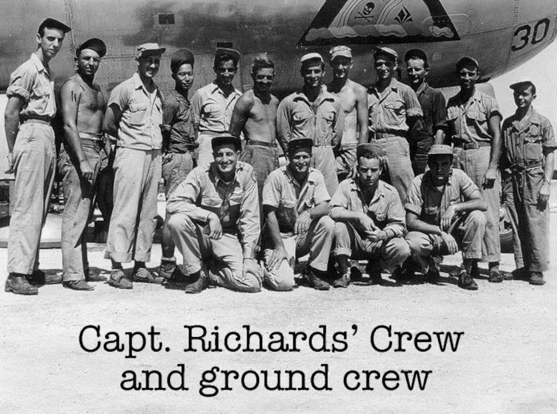 """Capt. Jeff Richards, aircraft commander of Crew # 3915, assigned to the 39th Bomb Squadron and flew B-29 Victor 30, """"Son of a B-29"""" was one of the original crews and flew 35 combat missions. Members of aircrew and the servicing ground crew pose for a picture on Tinian during the war.  Mrs. Glenda Richards attended the 6th Bomb Group's Portland reunion in honor of her late husband.  (Courtesy 6th Bomb Group Association)"""