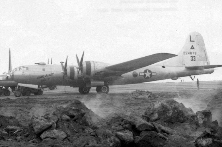 "Pictured here at Iwo Jima in 1945, ""Flak Alley Sally,"" was a Superfortress assigned to the 40th Bomb Squadron, a B-29-55-BW, serial number 42-24878.  Seen here refueling at Iwo Jima in 1945 following a raid on the Empire, she bears the early markings of the group with the ""L"" (6th Bomb Group identification letter) above a triangle (313th Bomb Wing identification symbol) above the aircraft serial number.  The ""33"" is an early Victor number (group/squadron aircraft identification number also used as a radio call sign number), which was later moved to the rear fuselage and changed to ""53."" (Courtesy 6th Bomb Group Association)"