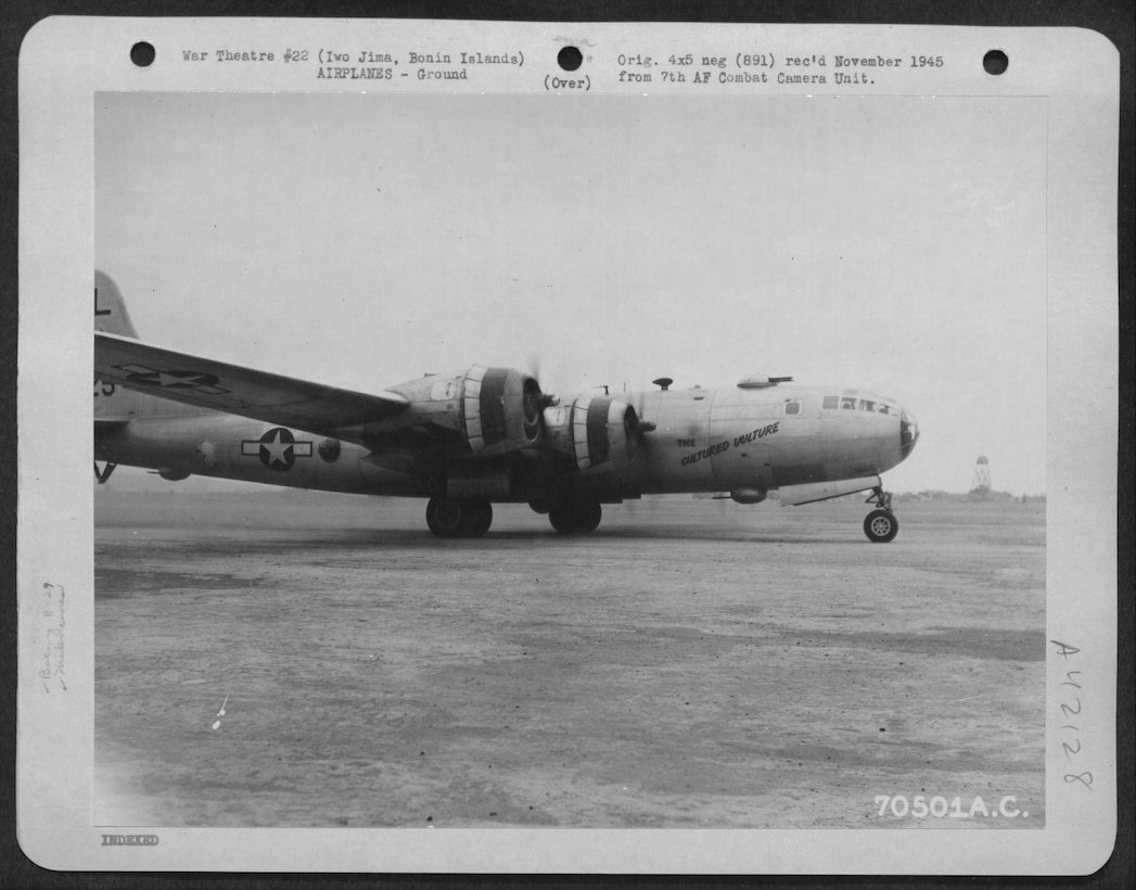 "Navigator Bob Frick flew many of his 31 combat missions with Crew # 3918 aboard ""The Cultured Vulture,"" a B-29-55-BW Superfortress, serial number 42-24901 assigned to the 39th Bomb Squadron.  Note the early markings of the 6th Bomb Group, with the ""L"" on top of the tail, and the lack of the Jean Lafitte motif on the nose.  This photo was taken at Iwo Jima on 10 March 1945, after ""The Cultured Vulture"" stopped for fuel following a raid on Tokyo and was preparing to return to Tinian.  (US Army photograph, courtesy National Archives via Fold3)"