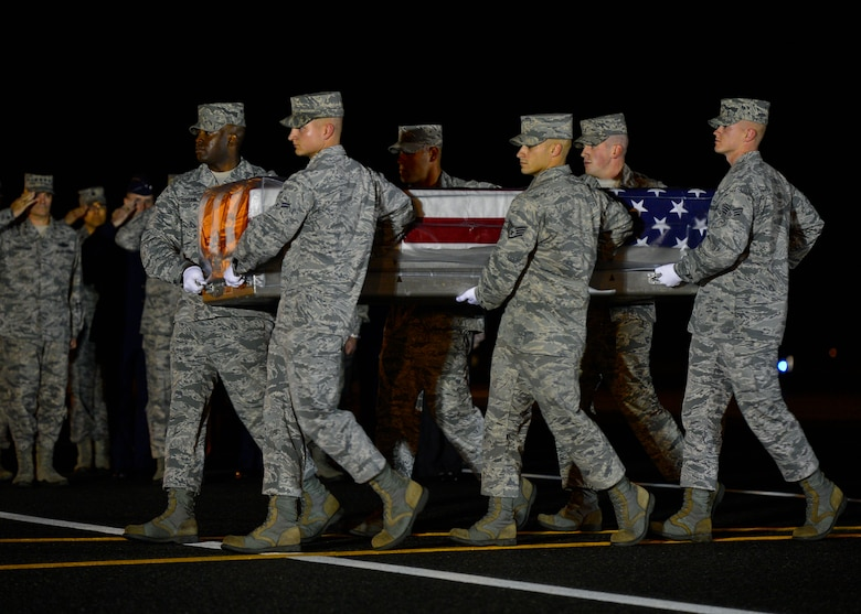 A U.S. Air Force carry team transfers the remains of U.S. Air Force Maj. Phyllis J. Pelky during a dignified transfer Oct. 13, 2015, at Dover Air Force Base, Del. (U.S. Air Force photo/Senior Airman Zachary Cacicia)
