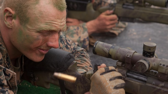 Cpl. Evan D. Taylor cycles the next round into the chamber of a M40A5 Sniper Rifle during a shooting competition between Republic of Korea and U.S. Marines at Baengnyeongdo, Republic of Korea, Sept. 11, 2015. Marines from both countries exchanged weapon systems, methods of concealment, and capabilities throughout the training. The exercise was part of Korean Marine Exchange Program 15-13, a bilateral training exercise that enhances the ROK and U.S. alliance, promotes stability on the Korean Peninsula, and strengthens ROK and U.S. military capabilities. Taylor, from Lusby, Maryland, is a scout sniper attached to Echo Company, 2nd Battalion, 3rd Marine Regiment, currently assigned to 4th Marine Regiment, 3rd Marine Division, III Marine Expeditionary Force, under the unit deployment program. The ROK Marines are with 6th Force Recon Company, 6th Brigade, 2nd ROK Marine Corps Division.