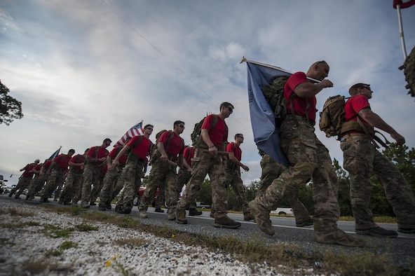 Special Tactics Airmen carry 20 batons during a memorial march to Hurlburt Field, Fla., Oct. 13, 2015. The team of 20 Special Tactics Airmen started at 2 a.m. on Oct. 4, from Joint Base San Antonio-Lackland, Texas, and marched 812 miles through five states to meet with the gold star families and end the memorial march with a ceremony on Hurlburt Field. Each two-man team walked approximately 90 miles during the 10-day trek while carrying a 50-pound ruck sack and a commemorative baton engraved with a fallen Special Tactics Airman's name. The memorial march is only held when a Special Tactics operator is killed in action that year, but honors all 19 Special Tactics pararescuemen and combat controllers who have been killed in action since 2001. (U.S. Air Force photo by Airman Kai White/Released)