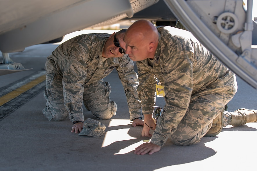 U.S. Air Force Col. Bradley Swanson, 153rd Airlift Wing Commander and Lt. Col. Todd Davis, 153rd Aircraft Maintenance Commander, look over the nose landing gear of a C-130H Hercules aircraft, tail number 1533, after it returned from maintenance at Hill Air Force Base, in Ogden, Utah. The aircraft landing gear was overhauled after a mechanical malfunction caused the aircrew to land with nose landing gear up while the aircraft was involved with fighting fires. (U.S. Air National Guard photo by Master Sgt. Charles Delano/released)