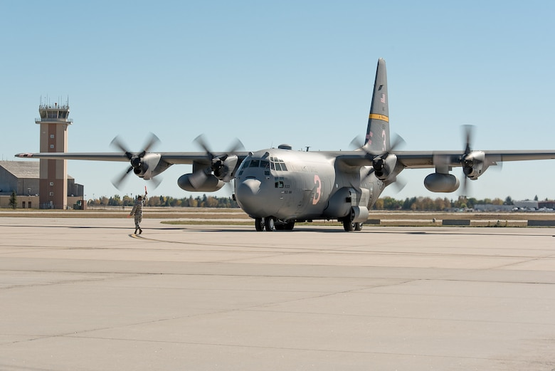 A C-130H Hercules aircraft, tail number 1533, returns to Cheyenne after 14 months of repair at Hill Air Force Base, in Ogden, Utah. The aircraft landing gear was overhauled after a mechanical malfunction caused the aircrew to land with a partially extended nose landing gear after the aircraft was involved with fighting fires. (U.S. Air National Guard photo by Master Sgt. Charles Delano/released)