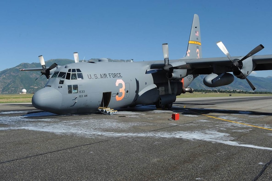 The Wyoming Air National Guard MAFFS 3 air tanker lands at Hill Air Force Base Aug. 17, 2014, without their nose gear. There were no injuries to the crew and minimal damage to the $37 million aircraft. (Photo courtesy of Hill Air Force Base, Utah)