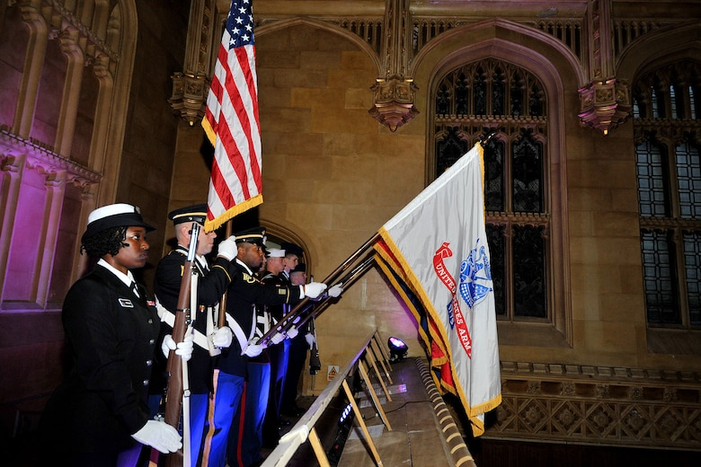 U.S. Service members assigned to the RAF Molesworth Joint Honor Guard present the colors during the Combined Joint Service Ball at King's College, Cambridge, United Kingdom Sept. 11, 2015. The only American joint honor guard team in the United Kingdom performs various ceremonies, such as retreats, retirements and funerals throughout England. (U.S. Air Force photo by Staff Sgt. Ashley Hawkins/Released)