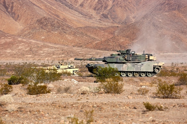 M1A1 Main Battle Tanks with Company A, 1st Tank Battalion, 1st Marine Division align themselves in order to provide fire support for British Royal Marines with 42 Commando Group during Exercise Black Alligator 2015 aboard Marine Air Ground Combat Center Twentynine Palms, Calif., Sept. 30, 2015. The exercise gave 1st Tanks an opportunity to hone and showcase their support capabilities, while building upon an already established relationship with the Royal Marines.     (U.S.Marine Corps photo by Cpl. Demetrius Morgan/RELEASED)