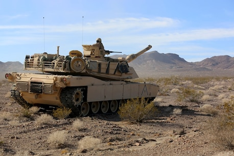 An M1A1 Main Battle Tanks with Company A, 1st Tank Battalion, 1st Marine Division, stops in order to provide fire support for British Royal Marines with 42 Commando Group during Exercise Black Alligator 2015 aboard Marine Air Ground Combat Center Twentynine Palms, Calif., Sept. 30, 2015. The exercise gave 1st Tanks an opportunity to hone and showcase their support capabilities, while building upon an already established relationship with the Royal Marines.     (U.S.Marine Corps photo by Cpl. Demetrius Morgan/RELEASED)