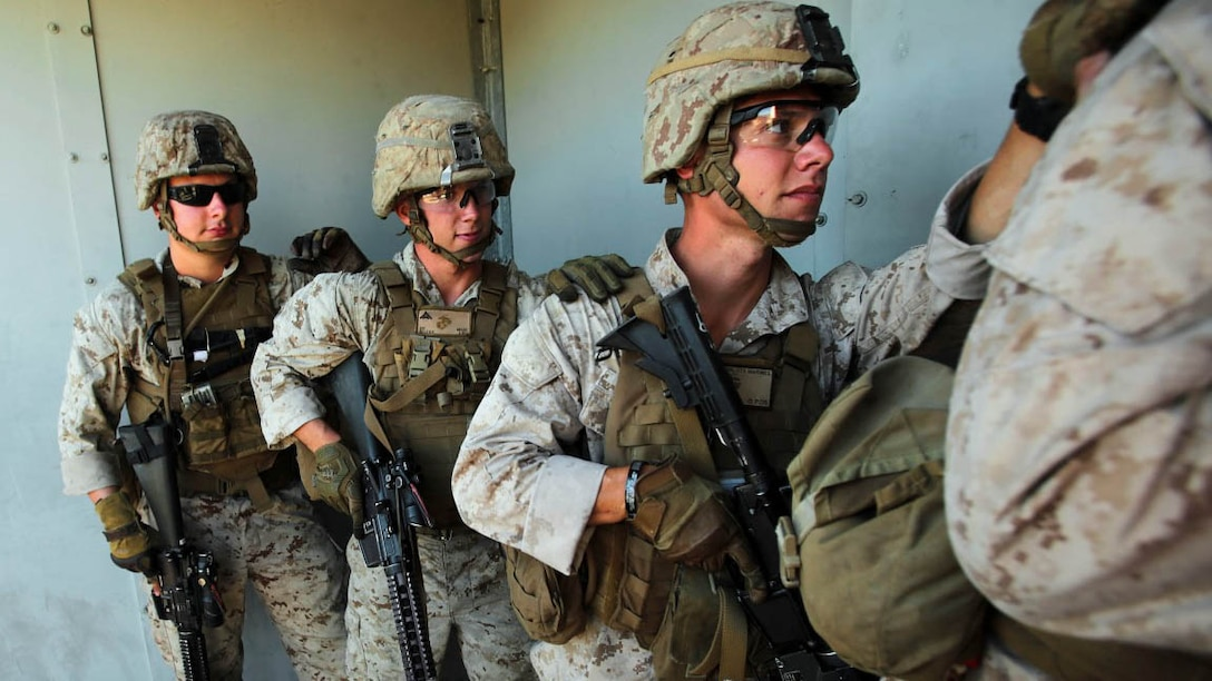 Marines assigned to the Urban Leaders Course at 1st Marine Division Schools, I Marine Expeditionary Force, prepare to clear a building during a live-fire training exercise aboard Marine Corps Base Camp Pendleton, Calif., Sept. 25, 2015. The class teaches fire team and squad leaders skills and tactics to be successful in urban environments, which they can share with the Marines they lead and the leadership of their entire unit.