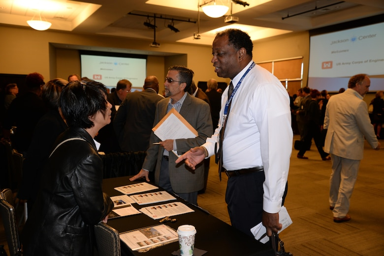 Su-Chen Chen, Huntsville Center's Facilities Reduction Program, speaks with Victor Curry of Vision Centric Inc. during the break-out session of the 2015 Small Business Forum Oct. 15 at the Jackson Center in Cummings Research Park, Huntsville, Alabama. Vision Centric is a small-disadvantaged, service-disabled, and veteran-owned business with the goal of providing program management, technical support and acquisition management support services to both government and commercial clients.